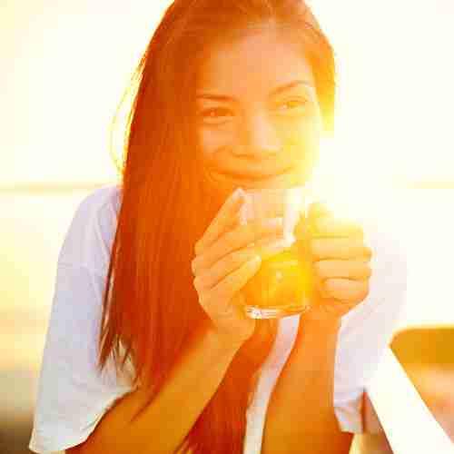 Woman Enjoying Coffee In The Sun