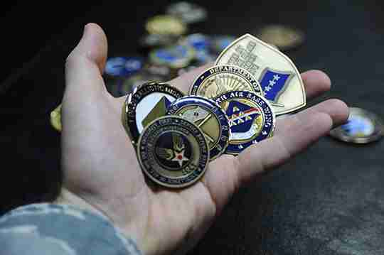 Challenge Coins in hand