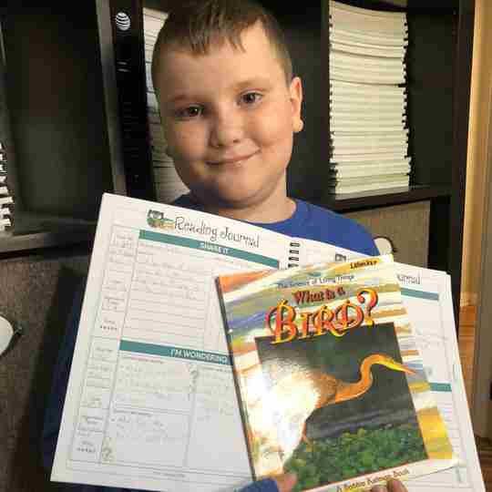 Luke with home school Reading Journal