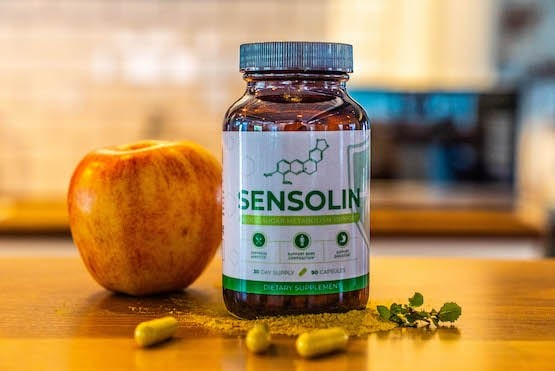 Sensolin bottle with an apple on a kitchen table