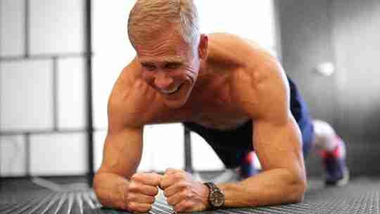 Fit Shirtless Man Doing Pushups in Gym