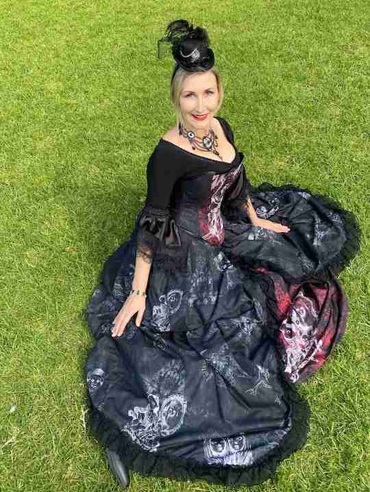 Silvia from Junee's most haunted homestead, Monte Cristo, wearing her custom made and designed art gown featuring photo negative style images of her favourite dolls