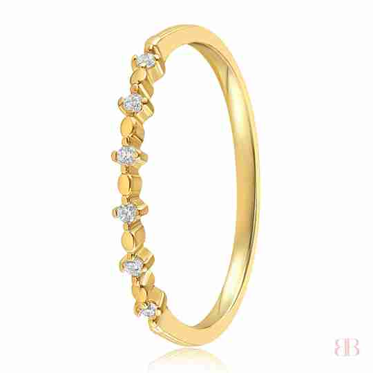 Gold ring embedded with six stones