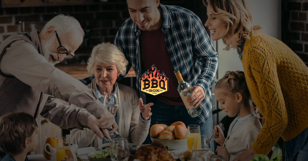 family enjoying a chicken meal, man carves chicken, BBQ box logo