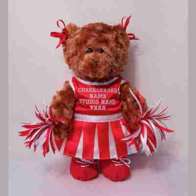 Brown bear with a red cheerleader dress.