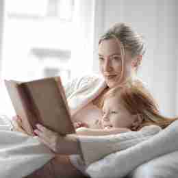Mom reading to her child