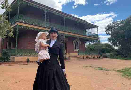 Silvia outside Monte Cristo Australia's most haunted homestead with one of her reborn dolls she created
