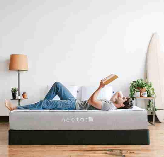 man relaxing on nectar mattress