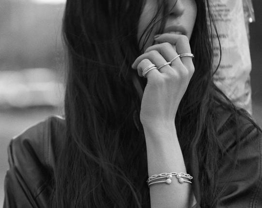 A model wearing multiple David Yurman rings