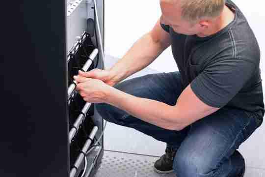 Technician maintain UPS battery units