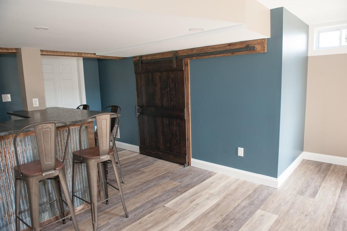 reclaimed pine barn door with a dark stain