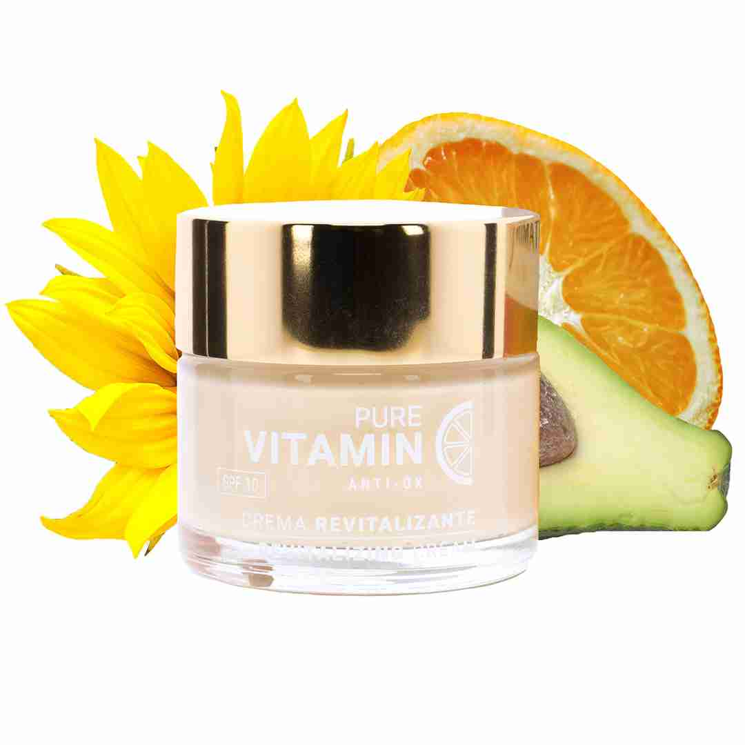 Pictured is Noche Y Dia's Vitamin C Face Cream surrounded by citrus slices and flowers.