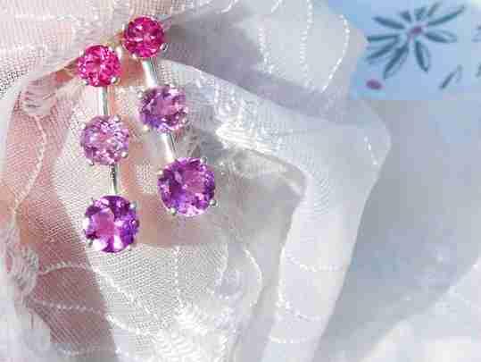 A set of pink gemstone earrings