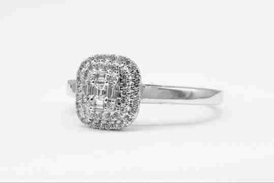 Emerald-cut diamond in a white gold ring