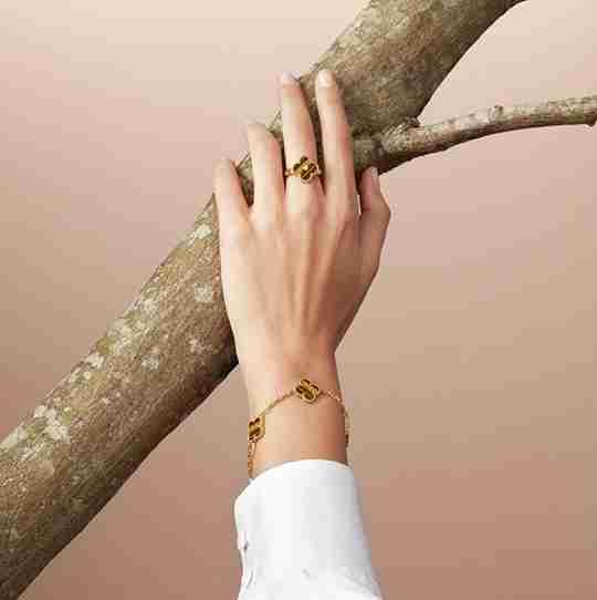 A woman wearing Van Cleef & Arpels ring and bracelet