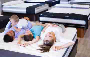 family on king size mattress