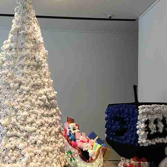 Christmas tree made of bears and one made of a dreidel.