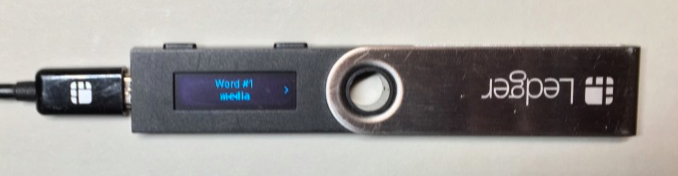 The Ledger Nano S screen showing Word #1