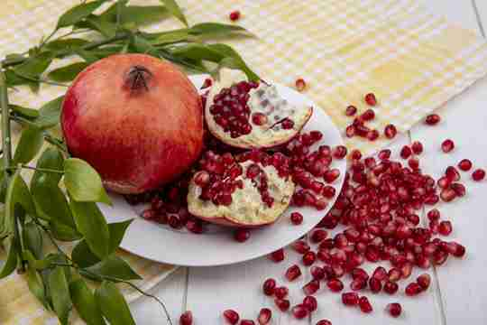 Pomegranate seeds and garnets mixed together
