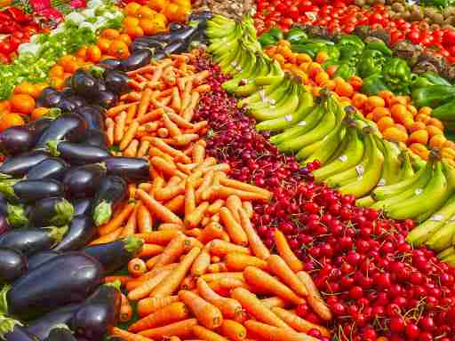 colorful vegetables eggplant carrots cherries bananas oranges green peppers tomatoes fruit