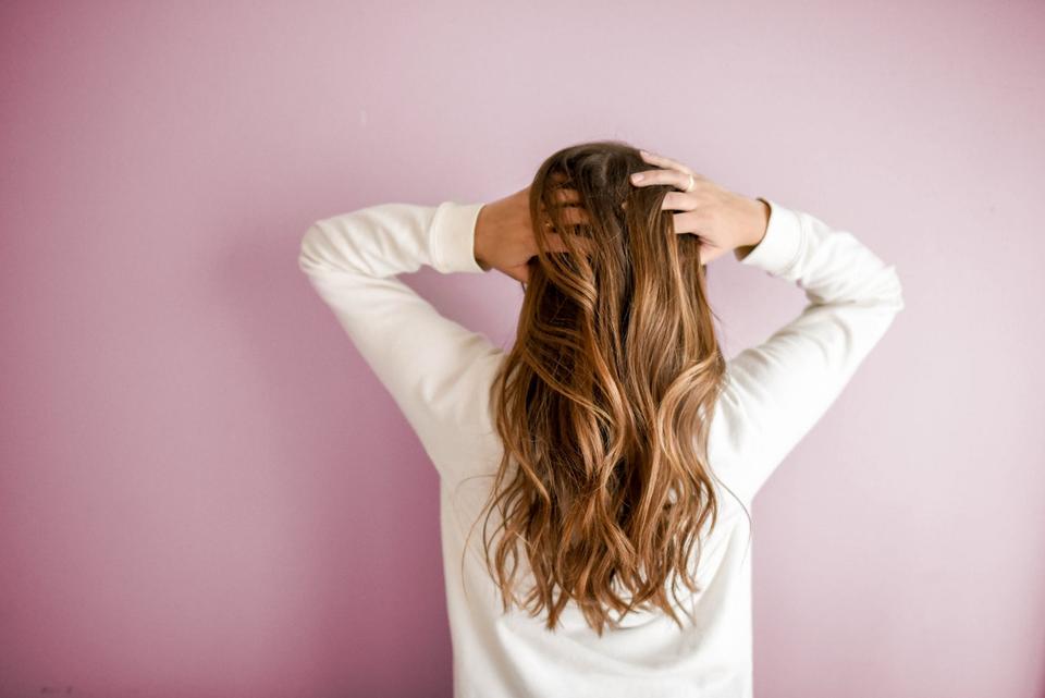 A woman massaging her beautiful hair