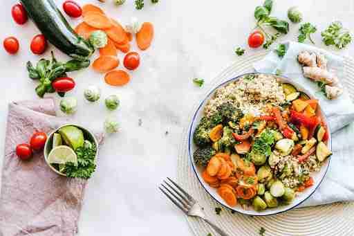 colorful vegetables carrots tomatoes zucchini quinoa brocolli cilantro lime
