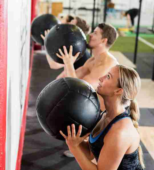 CrossFit athletes doing Wall Balls after consuming a citrulline supplement.