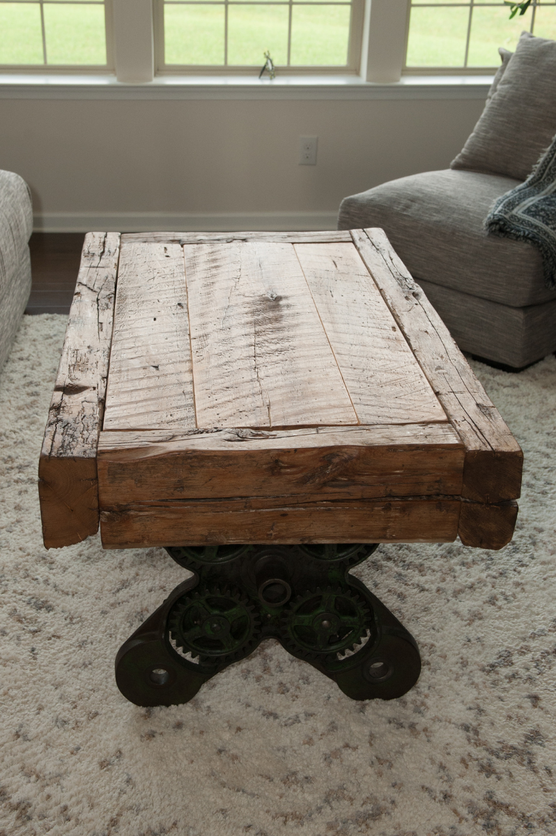 industrial base and reclaimed wood coffee table