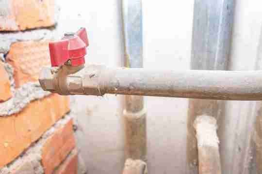 old lead pipe fixing to a home
