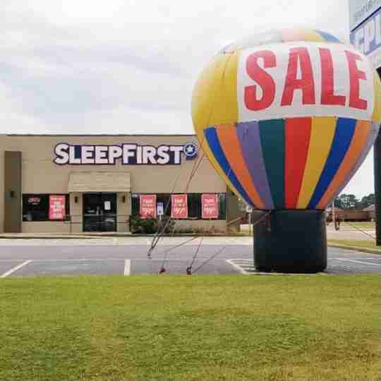 Sleep First Longview Texas Mattress Clearance Center exterior with huge colorful sale balloon