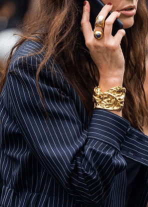 girl with gold rings and bracelet