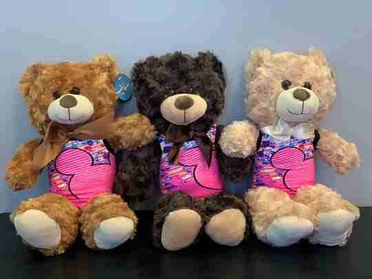 Three bears with gymnastics clothes sitting side by side.