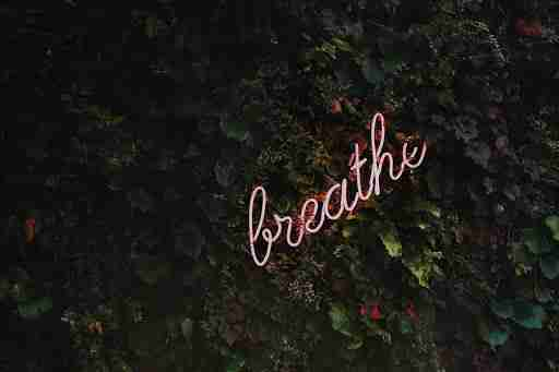 just breathe meditate sign