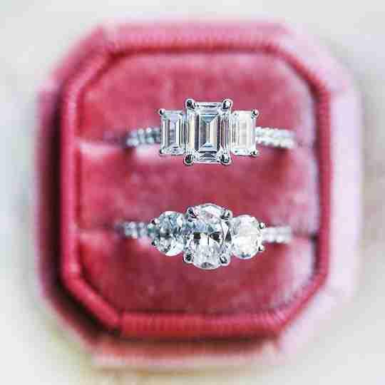 Two Ben Bridge diamond rings in a red velvet ring box