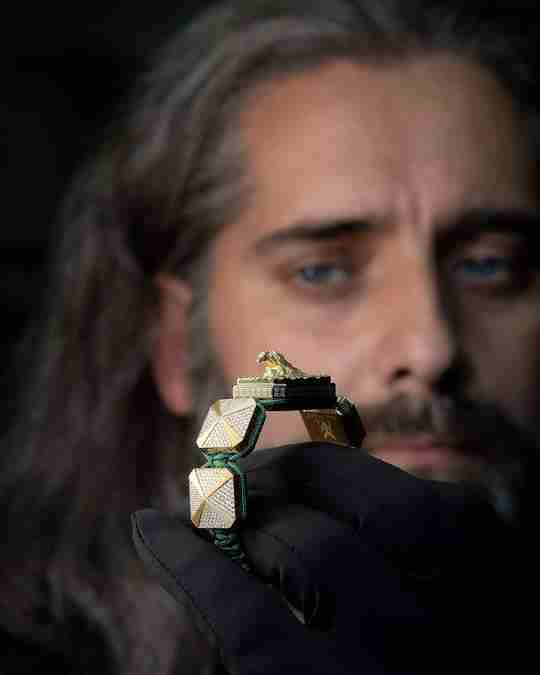 Jewelry designer Pablo Cimadevila holding a piece of jewelry