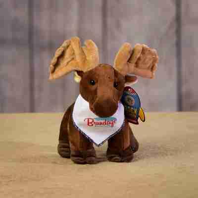 A brown moose wearing a white bandanna