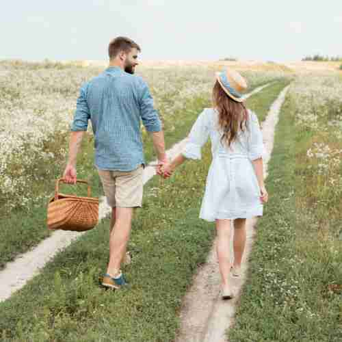 Couple Out Walking In The Country Down A Lane