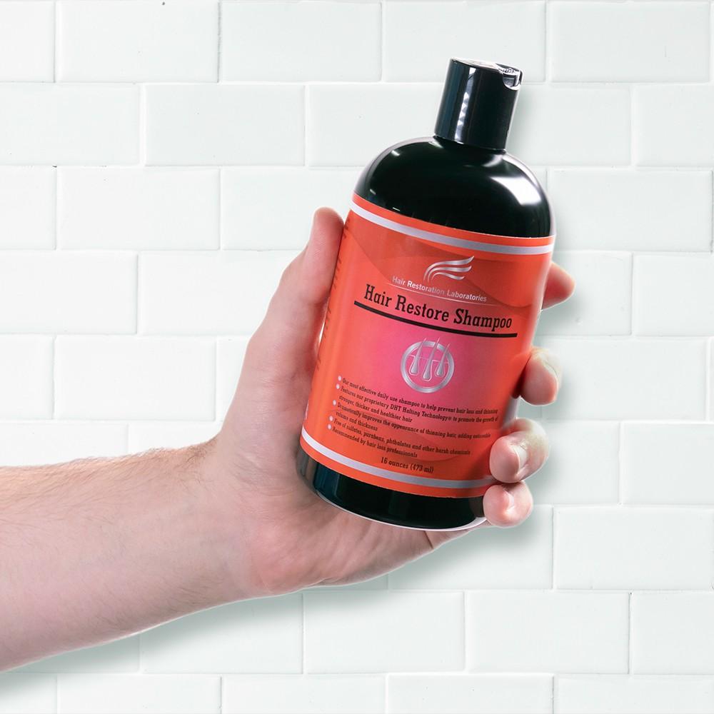 Image of person holding Hair Restoration Laboratories Hair Restore Shampoo