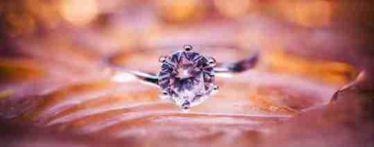 Diamond ring on pink background