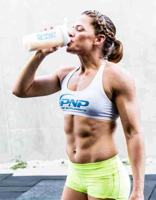 Female CrossFit athlete Luisa Porras drinking whey protein for its benefits.