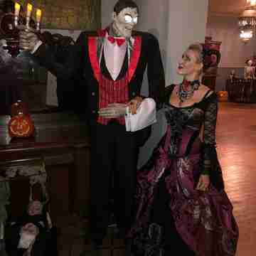 Silvia and Lurch at the Monte Cristo Haunted Ball 2018, Silvia is dressed in the Baroque Scrolls gown
