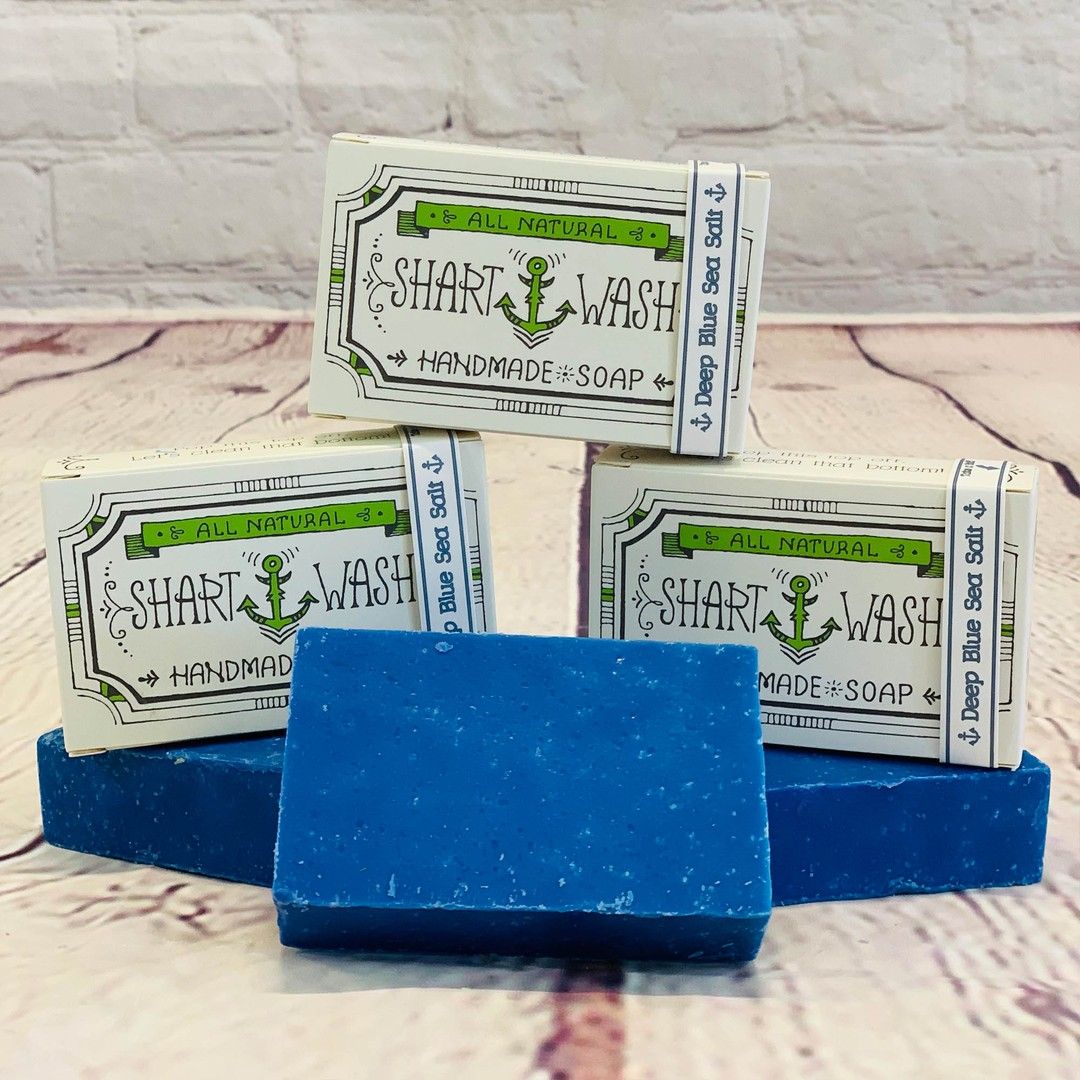 picture of 3 bars of blue shart wash natural handmade soap bars on a wood background