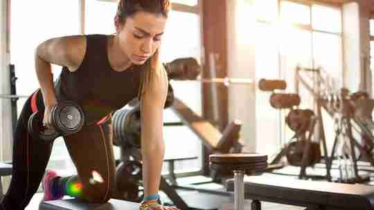 Fit Woman Exercising in Gym
