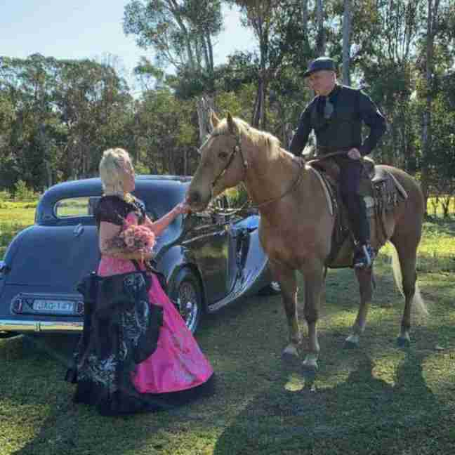 Danika & Craig on their wedding day when Craig surprised Danika by riding up on a horse