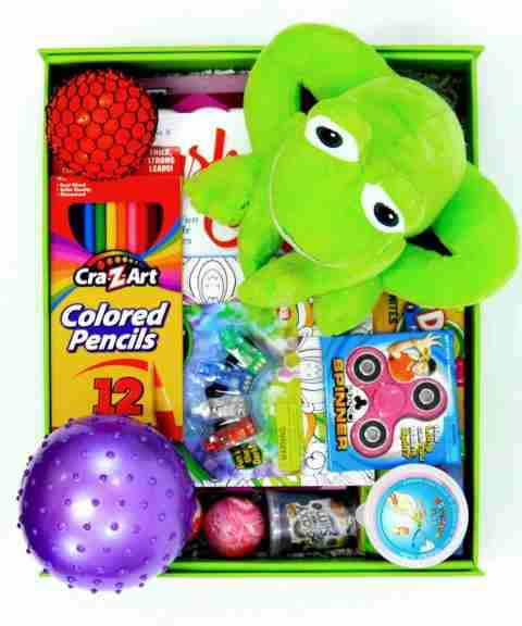 A big box full of gifts and a green frog.
