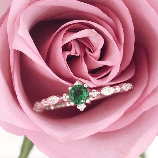 Alt: A Blush and Bar gold vermeil ring inside a rose