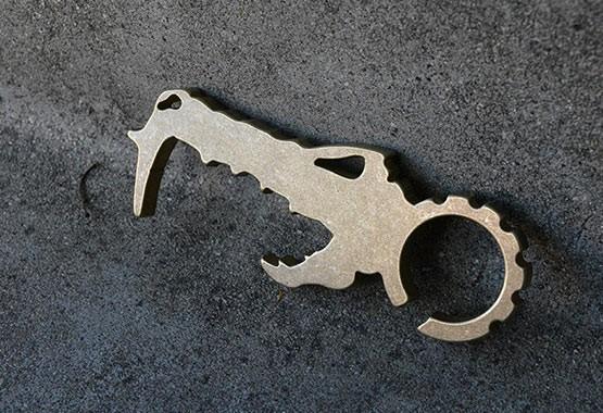 dino phobe brass pocket tool