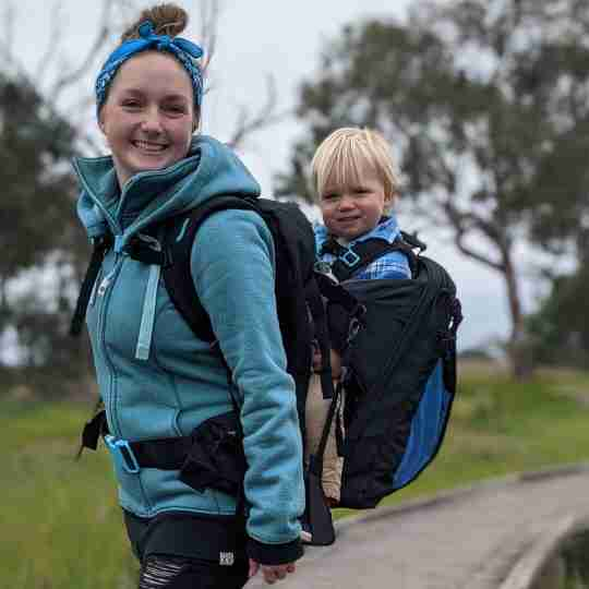 mum carrying toddler in baby carrier backpack