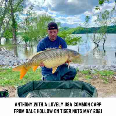 Anthony with a Common Carp caught on Tiger Nuts