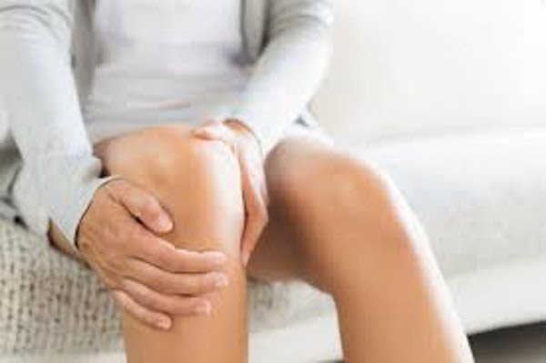 Woman Holding Leg On Couch